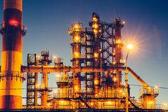 Oil refinery industrial plant or factory, storage distillery tanks and steel pipeline, modern petrochemical technologies. Toned stock images