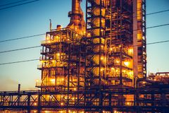 Oil refinery industrial plant or factory, storage distillery tanks and steel pipeline, modern petrochemical technologies. Toned royalty free stock photography