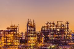 Oil refinery industrial plant or factory at sunset, storage distillery tanks and steel pipeline, modern petrochemical technologies royalty free stock photo