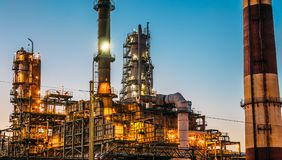 Oil refinery industrial plant or factory at sunset, storage distillery tanks and steel pipeline, modern petrochemical technologies. Toned stock photography