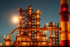 Oil refinery industrial plant or factory at sunset, storage distillery tanks and steel pipeline, modern petrochemical technologies royalty free stock image