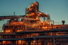 Oil refinery industrial plant or factory at sunset, storage distillery tanks and steel pipeline, modern petrochemical technologies stock photos