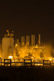Oil refinery industrial plant at night stock images