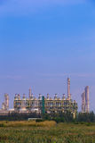 Oil refinery industrial plant with sky stock images