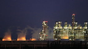 Oil refinery industrial plant with sky stock footage