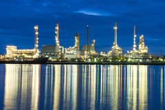 Oil refinery industrial in sunrise. Background Stock Photo