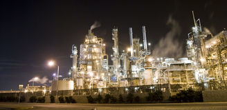 Oil refinery and industry. An oil refinery in the United States with a series of foggy and smoky stacks. Night image of an industrial complex Stock Photo