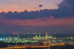Oil refinery industry with cityscape twilight sky background, Ba Stock Photo