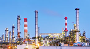 Oil refinery industry plant along twilight morning Stock Photos