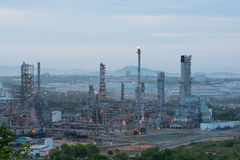 Oil refinery industry plant along twilight morning Stock Photo