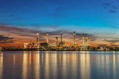 Oil refinery industry plant along twilight morning. Thai Stock Images