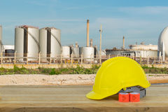 Oil refinery industry and yellow Safety Helmet with blue sky bac Royalty Free Stock Photos