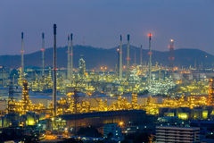 Oil refinery light nigh view with mountain Stock Image