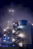 Oil refinery Mist. An oil refinery in the United States with a series of foggy and smoky stacks Royalty Free Stock Photos