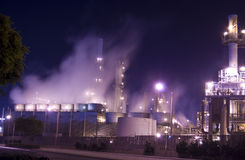 Oil refinery Mist. An oil refinery in the United States with a series of foggy and smoky stacks Stock Photo