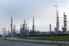Oil refinery in the mist royalty free stock photography