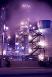 Oil refinery Mist stairs. An oil refinery in the United States with a series of foggy and smoky stacks. Industrial complex and stairs leading up into the smoke Stock Photo