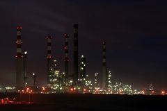 Oil refinery by night Stock Images