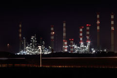 Oil refinery by night Royalty Free Stock Image