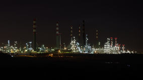 Oil refinery by night Stock Photos