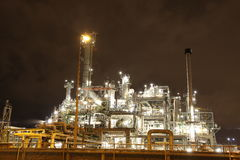 Oil refinery at night. Large oil refinery or petrochemical plant at night Stock Photography