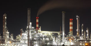 Oil refinery at night - factory - petrochemical plant Royalty Free Stock Photos