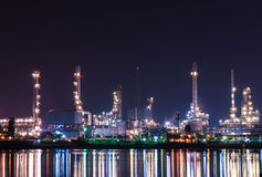 Oil refinery at night, heavy industry scene Royalty Free Stock Image