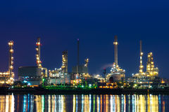 Oil refinery at night, heavy industry scene Stock Photo