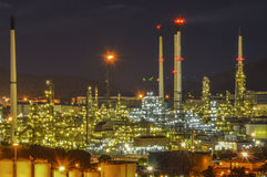 Oil refinery. At night.Petrochemicals are chemical products derived from petroleum Royalty Free Stock Images