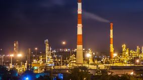 Oil refinery night timelapse stock video