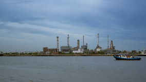 Oil Refinery or Oil Industry in front of Chao Phraya River, and sky sunset Day to night and ship transportation and factory concep stock video