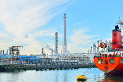 Oil refinery and oil tanker in the harbor of rotte Royalty Free Stock Photos