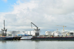 Oil refinery and oil tanker in the harbor of rotte Stock Image