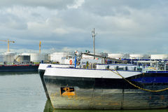 Oil refinery and oil tanker in the harbor of rotte Stock Photo