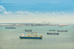 Oil refinery and oil tanker ship in sea, Singapore Royalty Free Stock Photography