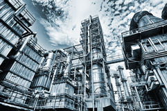Oil refinery in old vintage processing. Oil and gas refinery in old style grainy processing, pipelines and towers Royalty Free Stock Photo