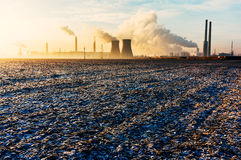 Oil refinery over frozen ground Royalty Free Stock Photography