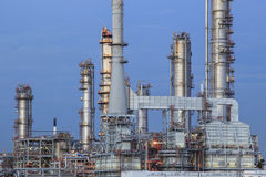 Oil refinery palnt against dusky blue sky in petrochemical indus Royalty Free Stock Photo