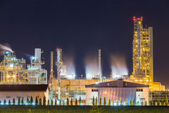 Oil refinery and petrochemical plant with cooling tower in twili Royalty Free Stock Image
