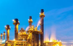 Oil refinery, petroleum and energy plant at twilight with sky background. royalty free stock image