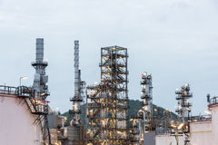 Oil refinery and Petroleum industry at night time Stock Photos