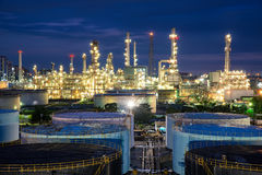 Oil refinery or petroleum refinery and storage tanks in night. Stock Image