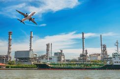 Oil refinery  with plane on blue sky.Power business concept.Logi. Stics concept Stock Photo