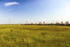 Oil refinery plant against Royalty Free Stock Images