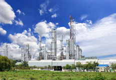 Oil refinery plant against Stock Photos