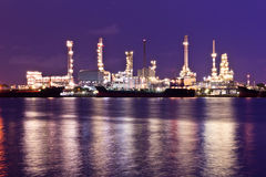 Oil refinery plant along river Stock Photos