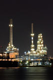 Oil refinery plant along river royalty free stock image