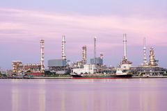 Oil refinery plant along river Stock Photo
