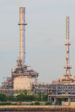 Oil refinery plant along the river Stock Photos