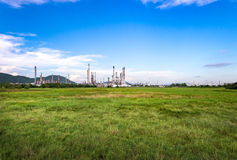 Oil refinery plant with blue sky royalty free stock photo